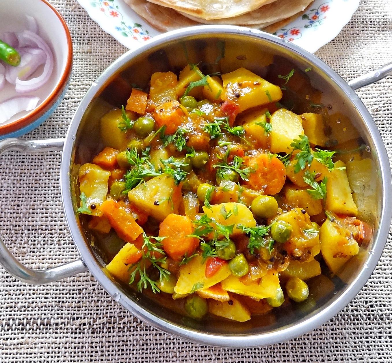 Aloo gajar matar ki sabji- Dry potatoes, carrots and peas curry